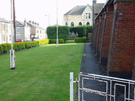 Lawn down side of Church from front